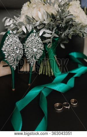 Wedding Attributes Of The Bride. Shoes Of The Bride. Bridal Bouquet. Rings Of The Bride And Groom. W
