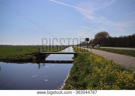 Ditch With Water In The Krimpenerwaard Area Between The Meadows Along Road N210 At Krimpen Aan Den I