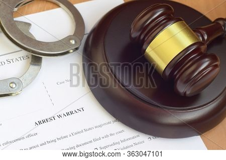 Justice Mallet And Arrest Warrant Blank Document With Police Handcuffs