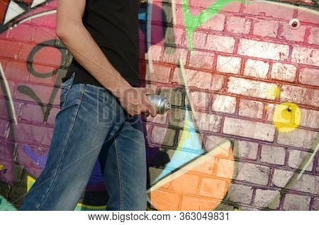 Young Graffiti Artist With Shows Your Spraycan As A Penis From Denims Fly Zipper Against Colorful Pi