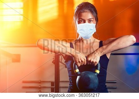 Indian Woman Doing Sport With Dumbbell At Home During Quarantine With Mask Protection. Stay At Home