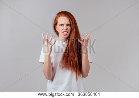 Redhaired Ginger Woman Feeling Anger And Wrath Breaking A Nail Manicure