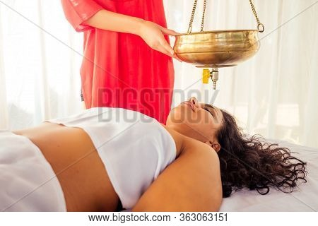Young Woman Doing Healthcare Indian Traditional Treatment In Ayurveda Body Constitution Centre