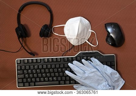 Smart Working During Covid-19 Or Coronavirus Disease. Computer Keyboard, Mouse, Headphone, Gloves An