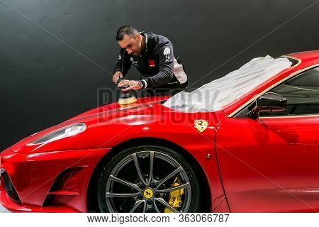 Professional Motor Vehicle Detailing Being Done To Luxury Sports Car