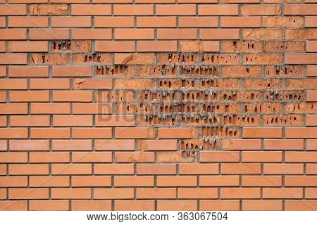Red Brick Crumbles In The Wall. The Facing Brick Crumbles. Destruction Of Brickwork On The Wall. She