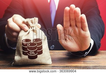 Man Refuses To Give A Bag With Oil Barrel Icon. Refusal To Purchase, Lack Of Space For Savings And S
