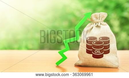 Bag With A Barrel Of Oil And A Green Arrow Up. Rising Oil Prices And Stabilization Of Energy Market.