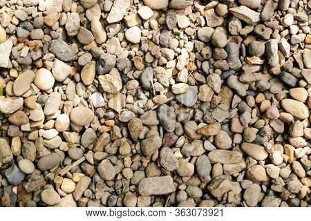 Various Pebble Stones For Background In Top View.