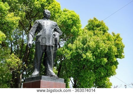 Shanghai, China - April 13, 2017: Statue Of Chen Yi At Huangpu Park In Shanghai, China With Green Tr