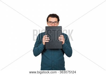 Introvert Businessman Looking To Camera, Covers His Mouth Using Briefcase, Hiding Facial Expression,