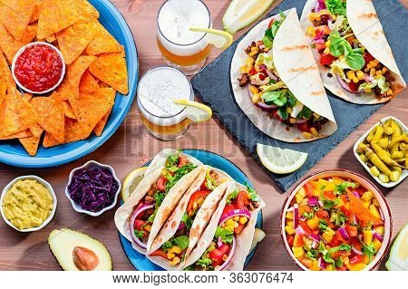 Table With Tacos, Mango Salsa, Nachos With Sauce, Guacamole, Lemon Beer For Cinco De Mayo Celebratio