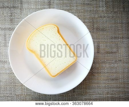 Artificial white bread slide on white plate