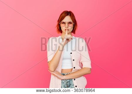 Woman Requires Silence. Young Beautiful Redhead Girl Has Put Forefinger To Lips As Sign Of Silence,