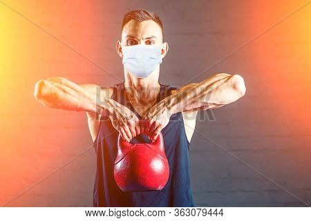 Indian Guy Doing Sport With Dumbbell At Home During Quarantine With Mask Protection. Stay At Home Ac