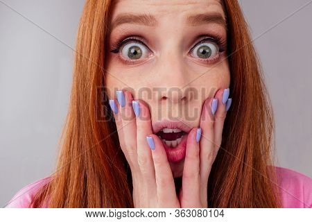 Amazed Redhair Ginger Woman Worried, Fear Expression In Studio Background Fish Eye