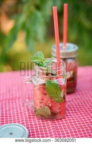 Strawberry And Mint Infused Detox Water. Strawberry Lemonade With Ice And Mint As Summer Refreshing