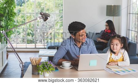 Mixed Race Family Staying Together, Caucasian Father Sitting And Working At Desk And Teaching Half-r