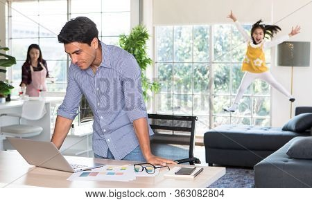 Mixed Race Family Staying Together, Caucasian Dad Working At Home At Desk While Mother Prepare Food
