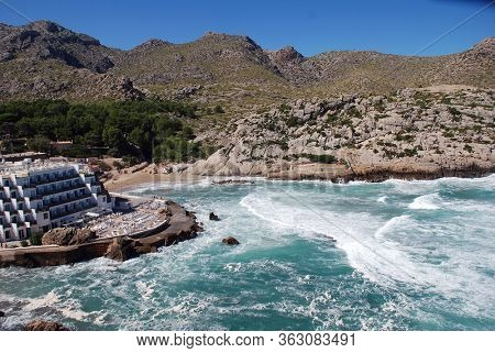 MAJORCA, SPAIN - OCTOBER 2, 2018: Rough seas at Cala Barques in the resort of Cala San Vicente. The bay is one of four separate coves at the resort.