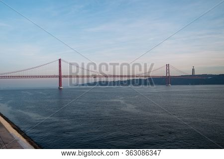The 25 Of April Bridge Or Ponte 25 De Abril In Lisbon.