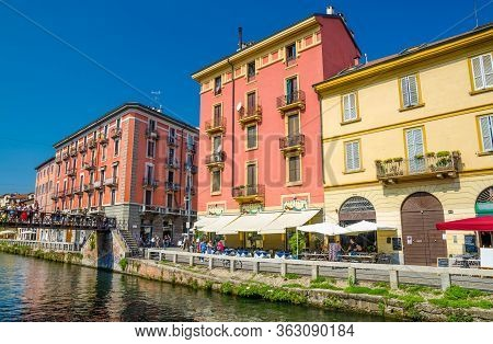 Milan, Italy, September 9, 2018: Typical Colourful Buildings And Bridge Pont De Fer Across Water Of