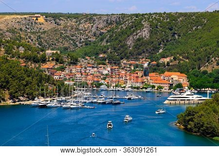 Summer Landscape Of The Croatian Small Town Skradin On Krka River. Beautiful Yachts And Orange Build