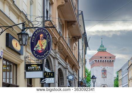 Krakow, Poland - May 13, 2019: Signboards In Krakow Main Shopping Street Florianska With Florianska