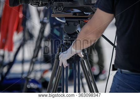 Details With The Hand In Gloves Of A Video Operator During The Covid-19 Lockdown. Coronavirus And Th