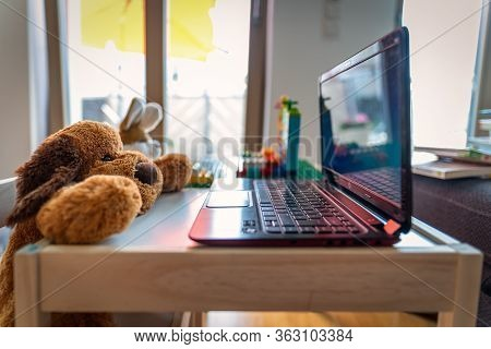 Homeoffice - Symbolic Photo Of A Stuffed Dog And Rabbit Which A Working On A Laptop At Home In The L