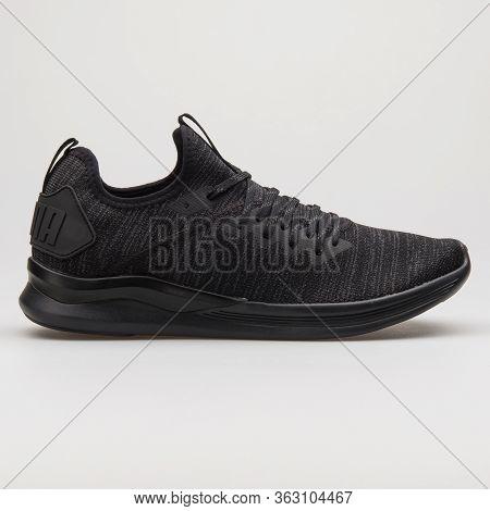 Vienna, Austria - February 14, 2018: Puma Ignite Flash Evoknit Black Sneaker On White Background.