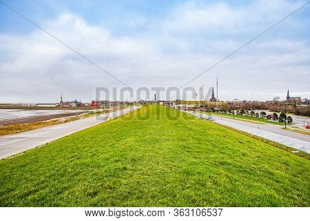 Harlingen, Netherlands - January 10, 2020. Panorama Of The Top Of Embankment With Sculpture Stenen M