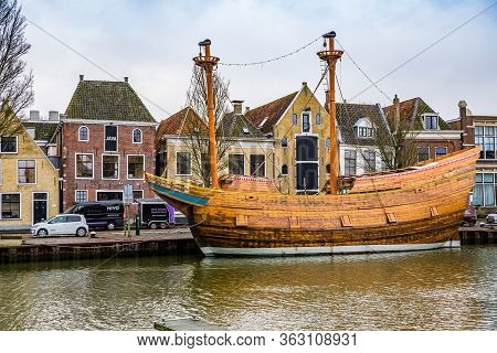 Harlingen, Netherlands - January 10, 2020. Old Historic Vessel In Zuiderhaven Canal In Winter