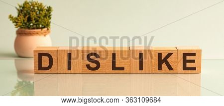 Dislike Word Written On Wood Block. Community Text On Wooden Table For Your Desing, Top View Concept
