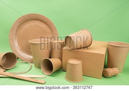 Tableware And Packaging Made Of Ecological Materials On A Green Background. Disposable Tableware.