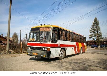 Asha, Russia - April 20, 2008: Red Intercity Coach Bus Hyundai Aero 600 In The City Street.