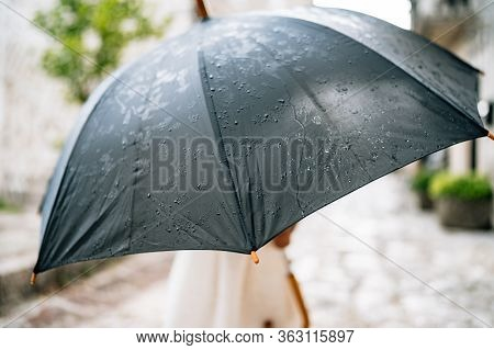 The Child Poses With An Umbrella. A Little Girl In A Dress Stands Outside Under An Umbrella Black Du