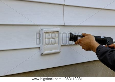Laundry The White Frame Of Exhaust Fan Dryer Fans With A Silicone Gun In An Apartment Building Trim