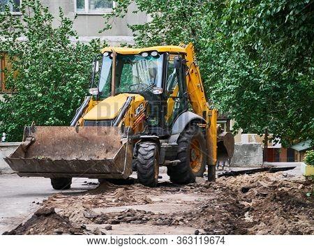 Hydraulic Excavator Removing Remains Of Asphalt. Road Reconstruction. Pavement Repair