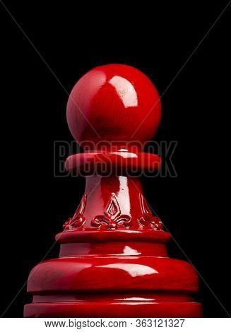 Macro Image Of A Wooden Chess Pawn In Red With Black Background