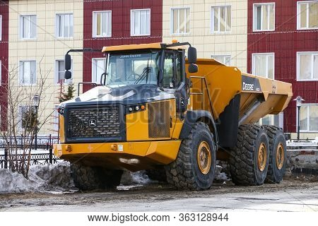 Novyy Urengoy, Russia - April 19, 2020: Articulated Dump Truck John Deere 410e In The City Street.