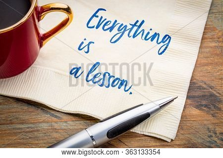 everything is a lesson inspirational quote - handwriting on a napkin with a cup of coffee, wisdom, experience, self improvement, growth and personal development concept