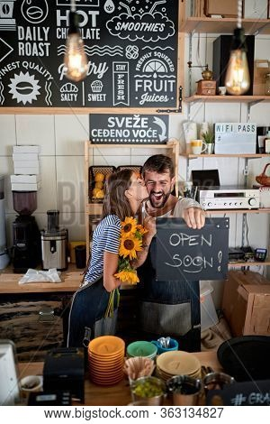 exited young couple having fun in their own cafe before opening. enthusiastic, excitement, joy, startup, business