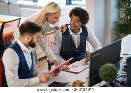 colleagues showing plan, report, data, stats, content on paper to a female boss. multiethnic, boss, employee, casual business concept