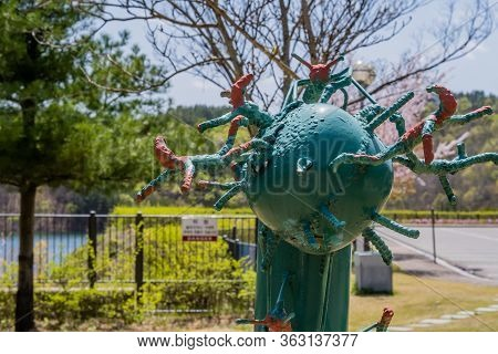 Jinan, South Korea; April 21, 2020: Closeup Of Iron Welded Sculpture Resembling A Virus In Rural Pub