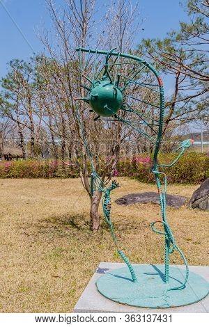 Jinan, South Korea; April 21, 2020: Iron Welded Sculpture Resembling A Virus In Rural Public Park. A