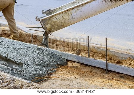 Industrial Workers Pouring Fresh Concrete On Reinforced Cement Sidewalk