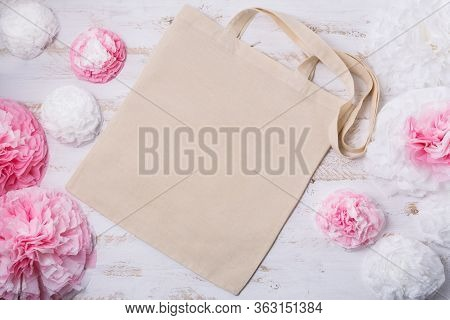 Canvas Tote Bag Mockup With White And Pink Paper Flowers. Empty Tote Bag Mock Up For Branding Presen