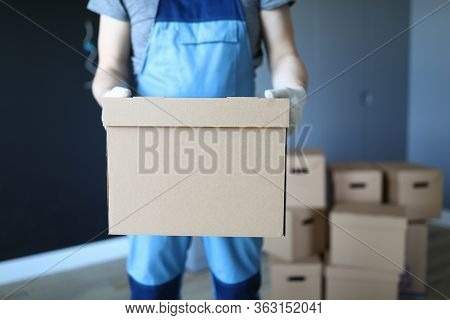 Man In Work Clothes Is Standing In Office With Box. Successfully Remove All Items From Home. Box Rel