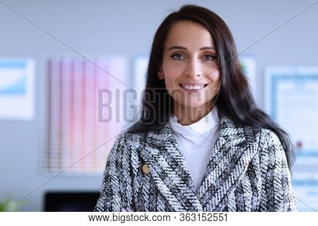 Confident Female Employee Smiling At Job Office. Employee Is Focused On Effectiveness Companys Busin